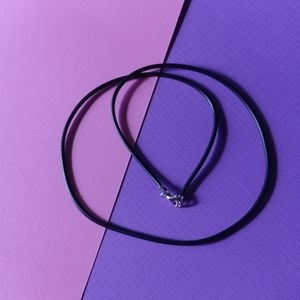 Jewelry - Sterling silver dragonfly on black rubber cord
